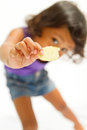 Ethnic child with snack on hand Stock Photos
