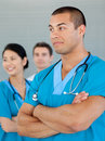 Ethnic doctor with his colleagues Royalty Free Stock Photo