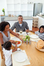 Ethnic family dining together Royalty Free Stock Photos