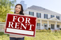 Ethnic Female Holding For Rent Sign In Front of House Royalty Free Stock Photo