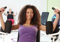 Ethnic girl exercising at the gym pretty on weight machine smiling Royalty Free Stock Photography