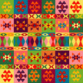Ethnic motifs background carpet with folk ornaments in different colors Stock Photography