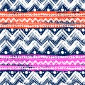 Ethnic pattern painted with zigzag brushstrokes vector seamless hand bold and stripes in bright colors can be used for print Stock Photos
