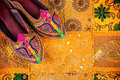 Ethnic rajasthan shoes colorful on yellow cushion cover on flea market in india Royalty Free Stock Photography