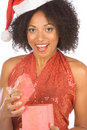 Ethnic woman surprised with Christmas present Royalty Free Stock Images