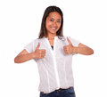 Ethnic young woman smiling and showing you ok sign portrait of an on white background Stock Photography