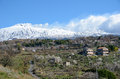 Etna with the fertile slope in the foreground active volcano is smoking above slopes early spring Royalty Free Stock Images