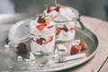 Eton mess classic british summer dessert called strawberries crushed meringue and whipped cream in jar Royalty Free Stock Photography