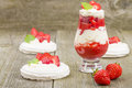 Eton mess strawberries with whipped cream and meringue in shot glasses classic british summer dessert Stock Photography