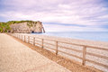 Etretat aval cliff landmark balcony and beach normandy france under a cloudy sky europe Stock Image