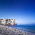 Etretat aval cliff landmark and its beach night photography normandy france starring europe long exposure Stock Images