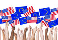 Eu and american flags people holding Stock Photos