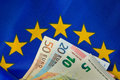 EU flag and Euro bank notes Royalty Free Stock Photo