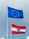 Eu flag and flag austria the european union the austrian Royalty Free Stock Photo