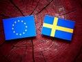 EU flag with Swedish flag on a tree stump Royalty Free Stock Photo