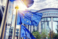 EU flags waving in front of European Parliament building in Brus Royalty Free Stock Photo