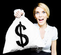 Euphoric business woman holding money bag Royalty Free Stock Image