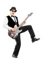Euphoric man playing a bass guitar full length portrait of an isolated on white background Stock Images