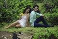 Eurasian siblings lounging Stock Photography