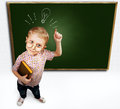 Eurica little boy with gesture standing near green schoolboard Stock Photo