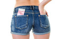Euro in back pocket young woman wearing jeans texas shorts with cash over white background Royalty Free Stock Images