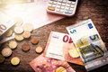 Euro banknotes and coins with bills to pay Royalty Free Stock Photo