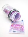 Euro banknotes in money jar