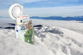Euro banknotes in the snow jar on mountain top Stock Photo