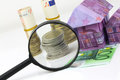 Euro bill House and expenses under magnifying glass Royalty Free Stock Photo