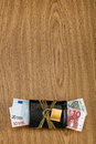 Euro bills in a locked wallet with golden chain and padlock. Royalty Free Stock Photo
