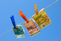 Euro bills on washing line Stock Images