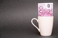 Euro coffee mug money banknote in a with copy space to the left focus is on the banknote Stock Photo