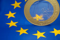 Euro coin on european flag Royalty Free Stock Image