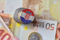 Euro coin with national flag of croatia on the euro money banknotes background. Royalty Free Stock Photo