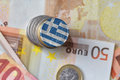 Euro coin with national flag of greece on the euro money banknotes background. Royalty Free Stock Photo