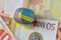 Euro coin with national flag of rwanda on the euro money banknotes background. Royalty Free Stock Photo