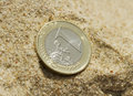 Euro coin on sand. Royalty Free Stock Photo