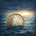 Euro coin sinking water euro crisis concept Stock Photos