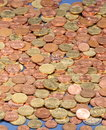 Euro coins background of bronze and golden colored lying on ground Stock Photography