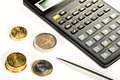 Euro coins, calculator and a pen Stock Photo