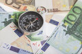 Euro compass magnetic on banknotes financial concept for the trend of the exchange rate inflation or deflation Royalty Free Stock Images
