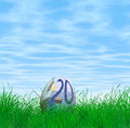 Euro currency easter egg nestled green grass blue sky cloudscape background Royalty Free Stock Photos