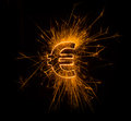 Euro currency sign in sparks on dark background Stock Image