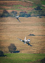 Euro fighter typhoon fighter jets in a low level dogfight Royalty Free Stock Photos