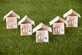 Euro houses on grassy land made of notes Royalty Free Stock Image