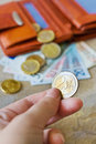 Euro money - banknotes and coins - in brown wallet Royalty Free Stock Photo