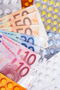 Euro money bills and  pills Royalty Free Stock Photo