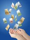Euro money falling to hands. Stock Images
