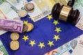 Euro money with hammer on eu flag Royalty Free Stock Photo