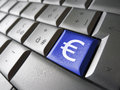 Euro money symbol computer key european union financial concept image with sign and icon on a blue laptop for blog website and Royalty Free Stock Image